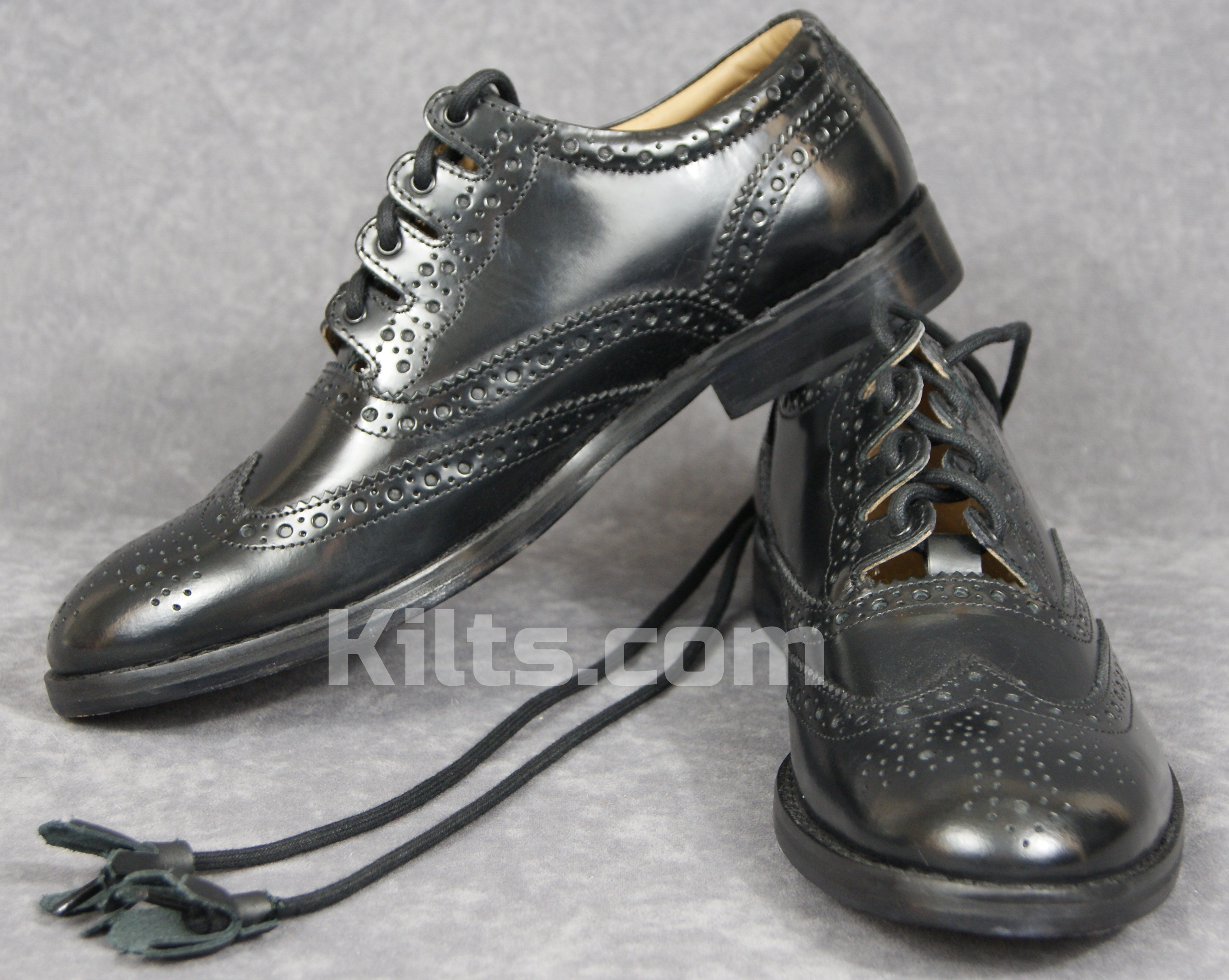 Check out our Glenfinnan Ghillie Brogues. They are the perfect kilt shoes.