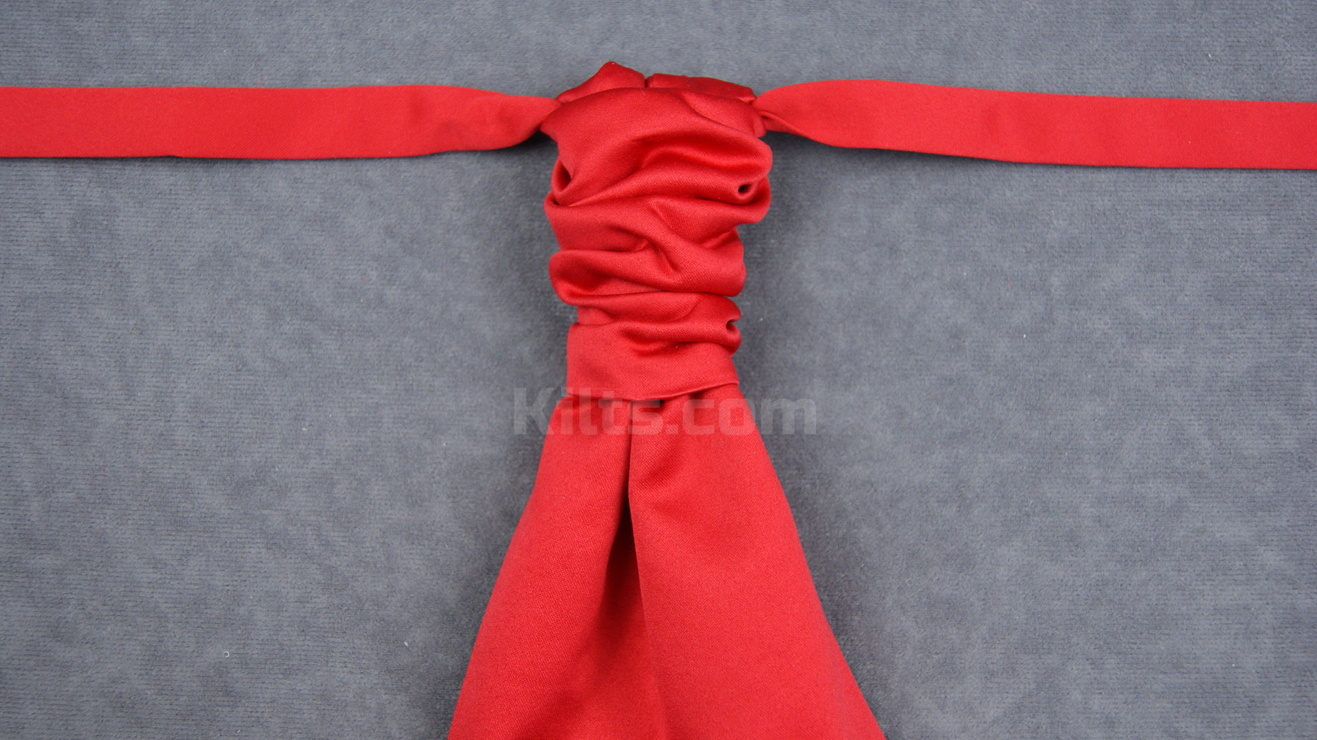 Here is our Red Ruche Tie for sale.